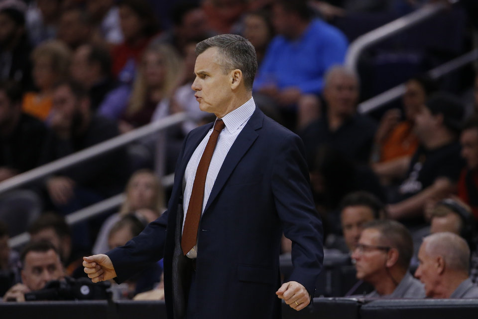 Photo - Oklahoma City Thunder head coach Billy Donovan watches his players during the first half of an NBA basketball game against the Phoenix Suns Friday, Jan. 31, 2020, in Phoenix. The Thunder defeated the Suns 111-107. (AP Photo/Ross D. Franklin)