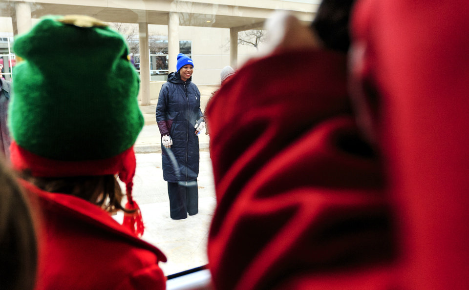 Photo - City councilwomen Nikki Nice watches a streetcar go by as people get free rides on the streetcar to celebrate the grand opening ceremony of the Oklahoma City streetcar system in downtown Oklahoma City, Okla. on Friday, Dec. 14, 2018. Photo by Chris Landsberger, The Oklahoman