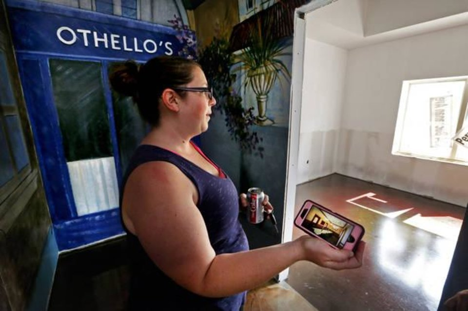 Photo -  Jennifer Dennis, owner, shows details of the overhauled Othello's Italian Restaurant on Friday in Norman. The restaurant was destroyed in a fire last year. [Photo by Steve Sisney, The Oklahoman]