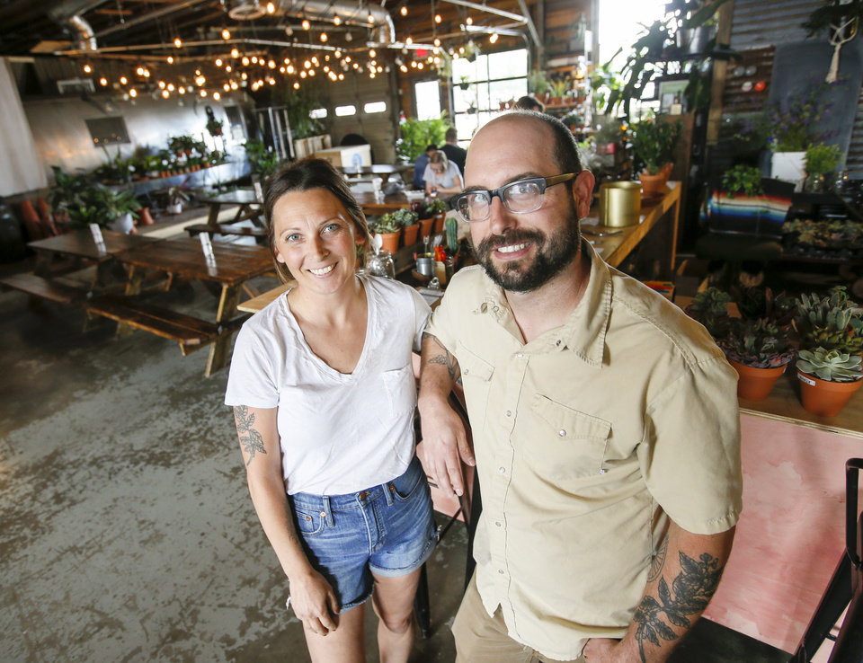 Photo -  Jen Semmler Grubbs and Chad Grubbs are shown inside the Plant Shoppe & Okay Yeah Co., 705 W Sheridan. [Photo by Nate Billings, The Oklahoman]