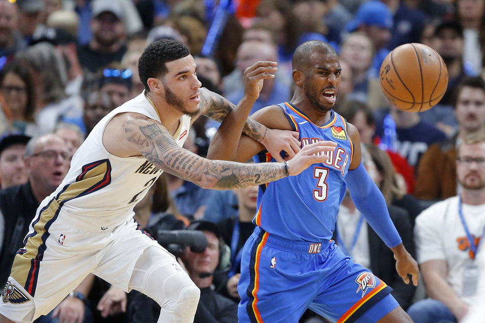 Photo - Oklahoma City's Chris Paul (3) goes for the ball beside New Orleans' Lonzo Ball (2) during an NBA basketball game between the Oklahoma City Thunder and the New Orleans Pelicans at Chesapeake Energy Arena in Oklahoma City, Saturday, Nov. 2, 2019.  [Bryan Terry/The Oklahoman]