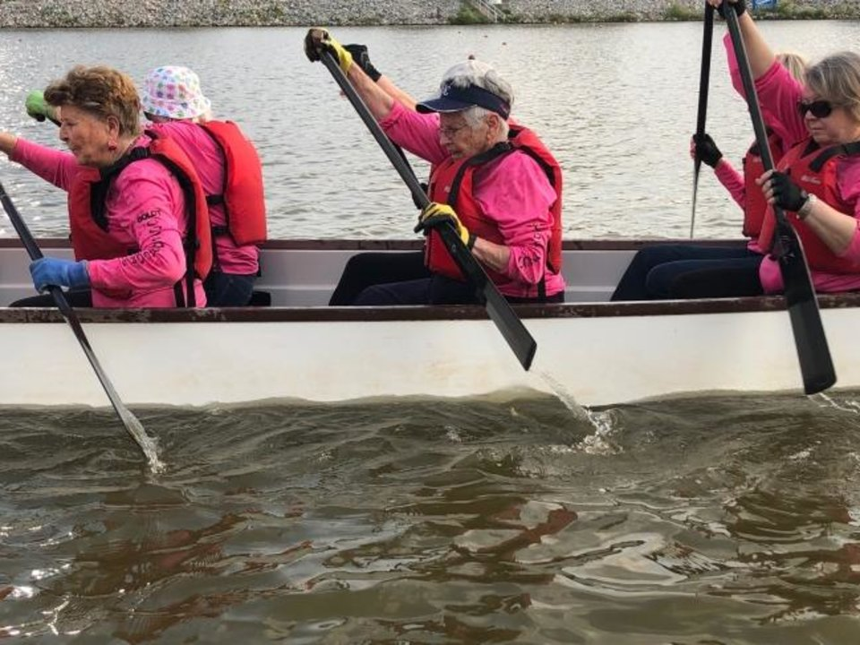 Photo -  Spanish Cove residents, including three in their 90s, oared two dragon boats in last year's Oklahoma Regatta festival. [PROVIDED]
