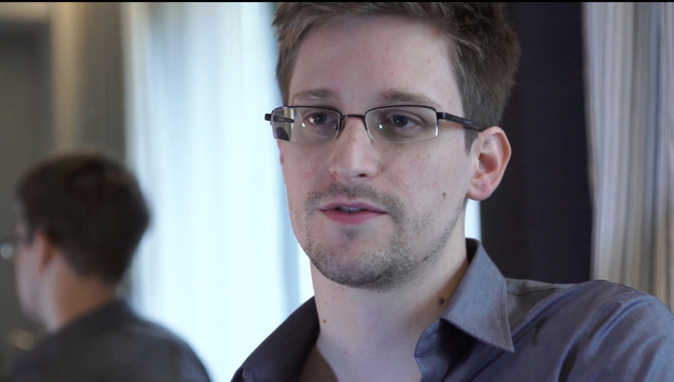 Photo - This photo provided by The Guardian Newspaper in London shows Edward Snowden, who worked as a contract employee at the National Security Agency, on Sunday, June 9, 2013, in Hong Kong. NSA leaker Edward Snowden claims the spy agency gathers all communications into and out of the U.S. for analysis, despite government claims that it only targets foreign traffic. (AP Photo/The Guardian, Glenn Greenwald and Laura Poitras) ORG XMIT: LON124