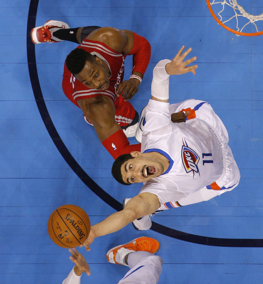 Photo - Oklahoma City's Enes Kanter (11) reaches for the ball beside Houston's Dwight Howard (12) during an NBA basketball game between the Oklahoma City Thunder and the Houston Rockets at Chesapeake Energy Arena in Oklahoma City, Tuesday, March 22, 2016. Photo by Bryan Terry, The Oklahoman