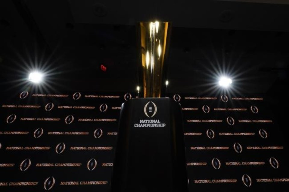 Photo -  The challenge ahead for the College Football Playoff selection committee is significant. [AP Photo/David J. Phillip]