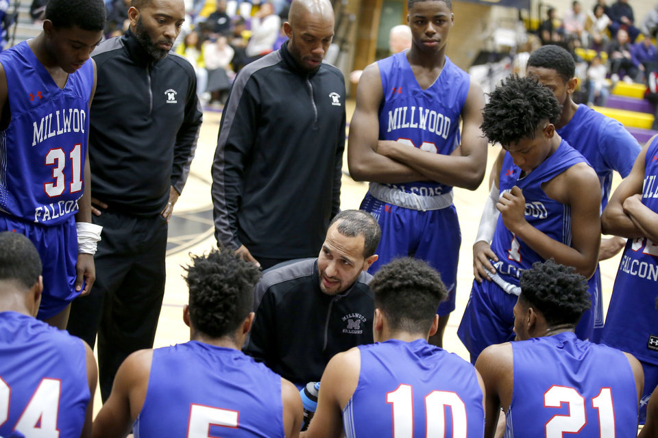 Photo - Millwood coach Mike Jeffries talks to his team during a game at Northwest Classen in Oklahoma City on Jan. 28. [Sarah Phipps/The Oklahoman]