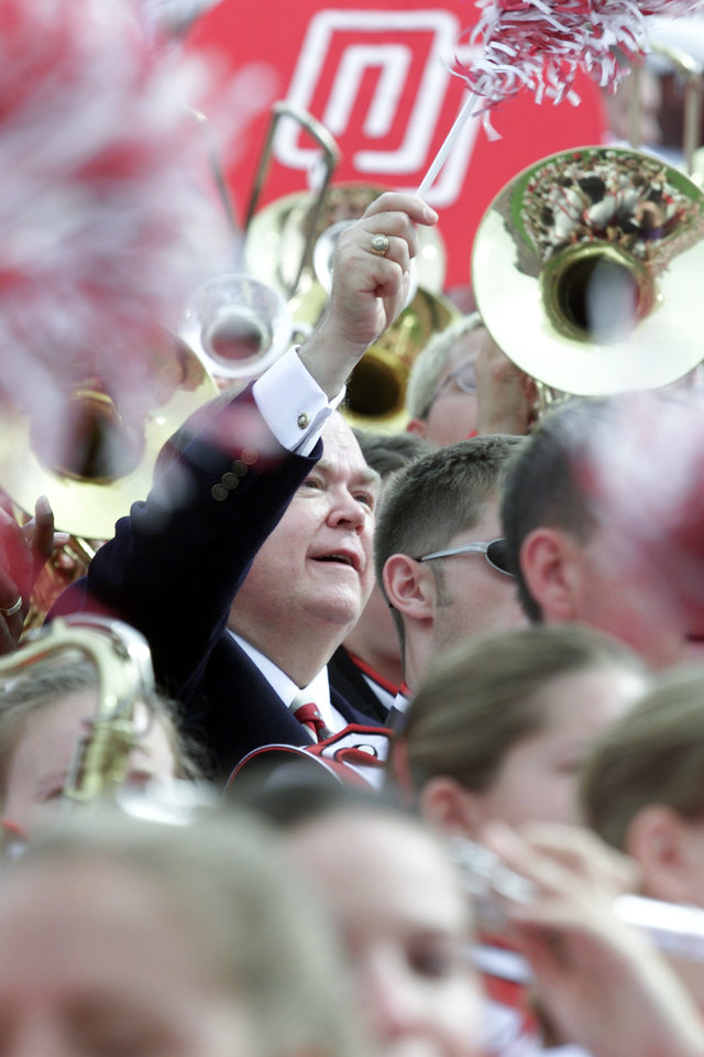 Photo - University of Oklahoma President David Boren watches the OU Sooners vs Nebraska football game surrounded by the Pride of Oklahoma Band. Staff Photo by Jaconna Aguirre