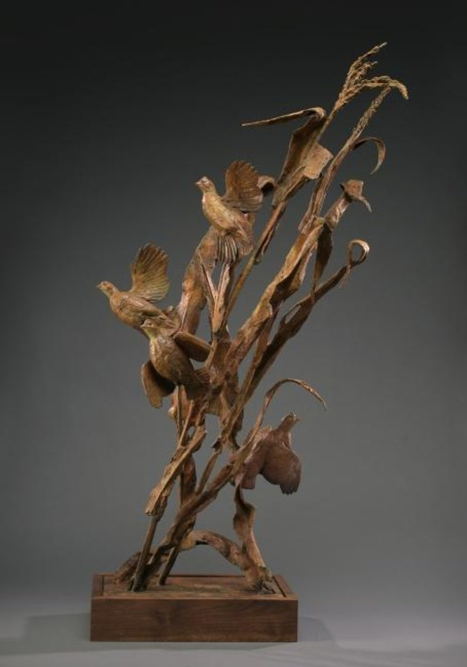 "Photo -  Wildlife sculptor Walter Matia's ""Corn Flowers,"" a bronze priced at $20,000, shows four quail being flushed from their hiding place in a cornfield. It will be featured in the 47th annual Prix de West Invitational Art Exhibition & Sale June 7-8 at the National Cowboy & Western Heritage Museum. [Image provided]"
