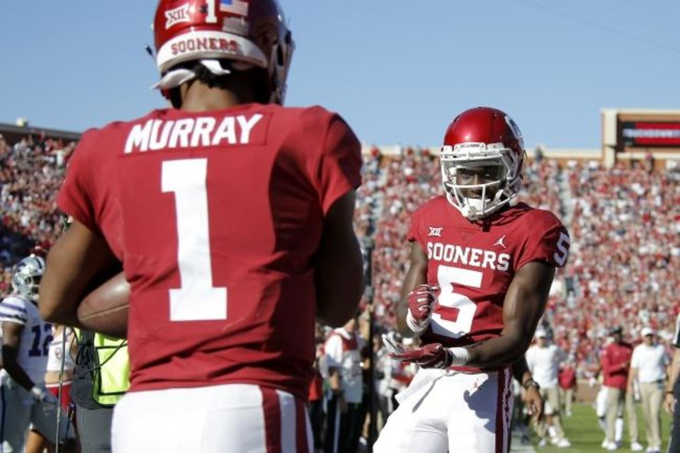 Photo -  Oklahoma's Marquise Brown (5) celebrates with Kyler Murray during the Sooners game against Kansas State last season. Both Brown and Murray were first-round picks in the NFL Draft. [BRYAN TERRY/THE OKLAHOMAN]