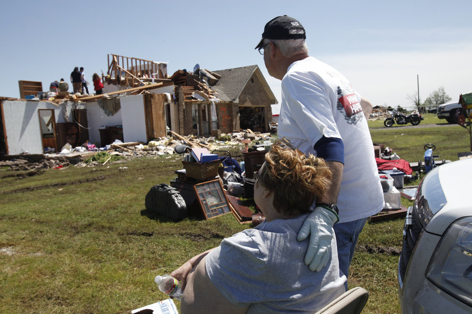 Photo - (Left) Bonnie Meritt of Union City, being consoled by a friend on Saturday, June 1, 2013 after the tornado outbreak in Canadian county on May 31, 2013 destroyed part of her house. Photo by Aliki Dyer, The Oklahoman
