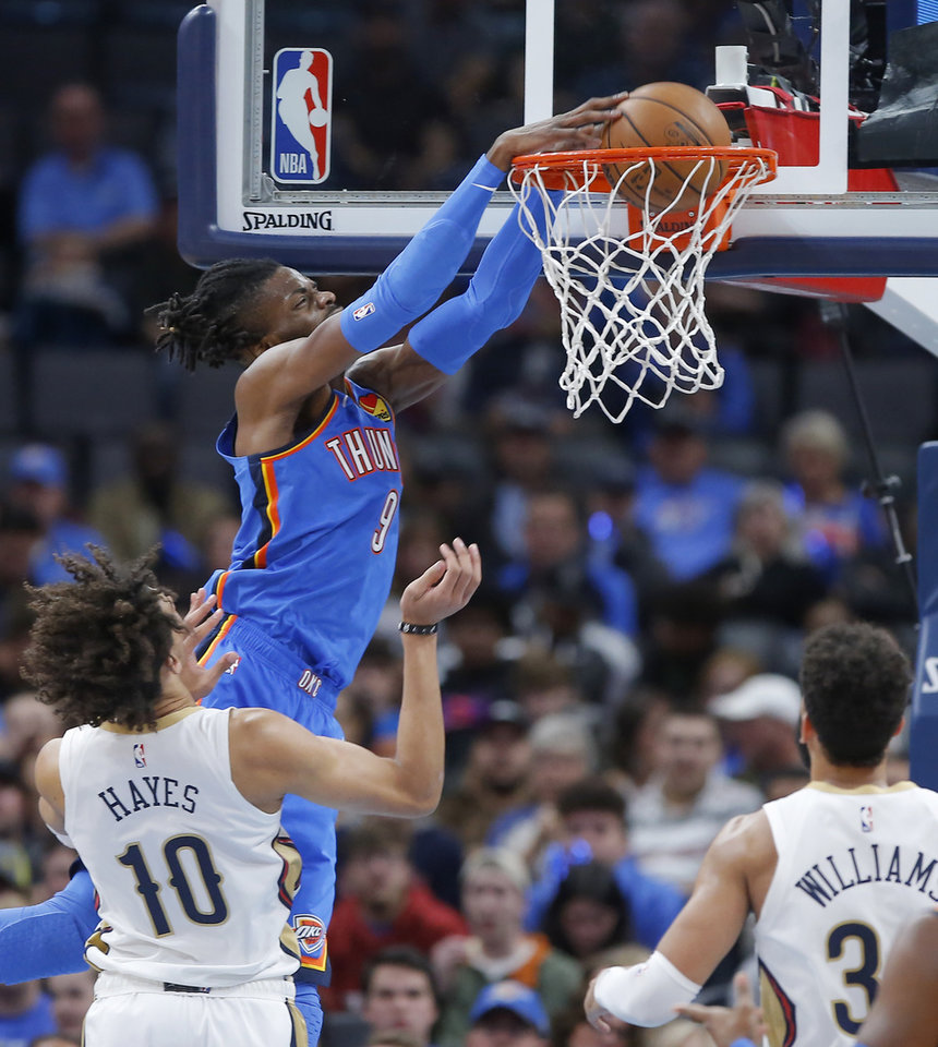 Photo - Oklahoma City's Nerlens Noel (9) dunks the ball over New Orleans' Jaxson Hayes (10) during an NBA basketball game between the Oklahoma City Thunder and the New Orleans Pelicans at Chesapeake Energy Arena in Oklahoma City, Saturday, Nov. 2, 2019. Oklahoma City won 115-104. [Bryan Terry/The Oklahoman]