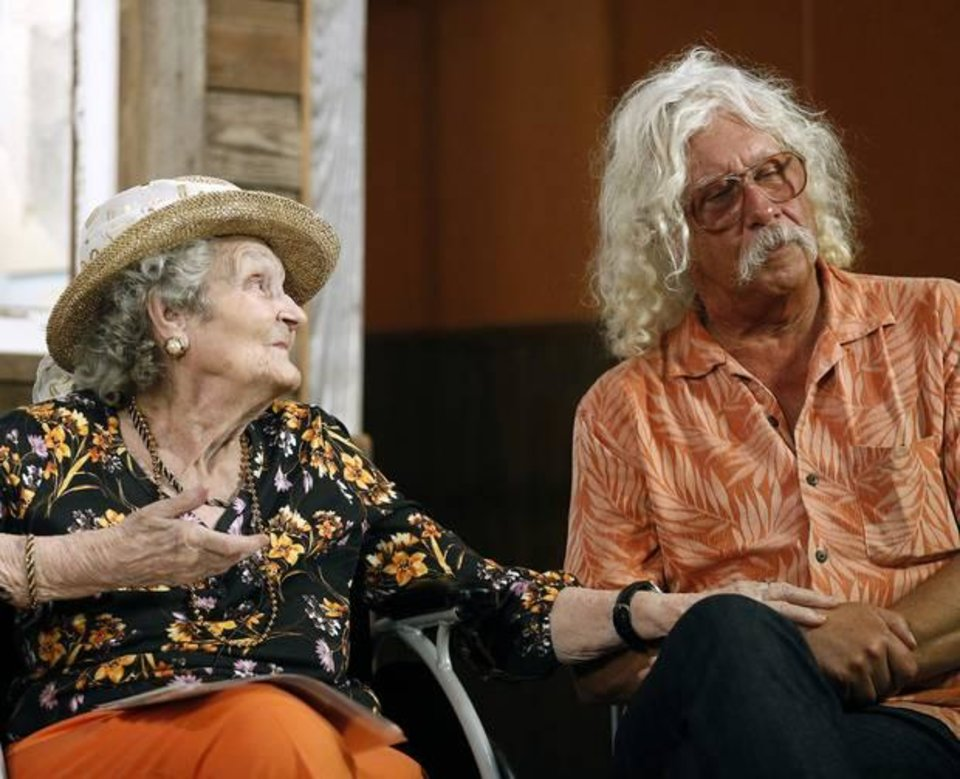 Photo - Woody Guthrie's sister Mary Jo Guthrie Edgmon, 91, and son Arlo Guthrie tell stories about Woody during the Woody Guthrie Festival in Okemah, Okla., Friday, July 11, 2014. [Photo by Sarah Phipps, The Oklahoman Archives]