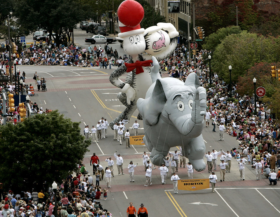 Photo - BALLOONS: The Cat in the Hat and Horton, make their way down Broadway during the Oklahoma Centennial Parade in Oklahoma City on Sunday, Oct. 14, 2007. By John Clanton, The Oklahoman ORG XMIT: KOD