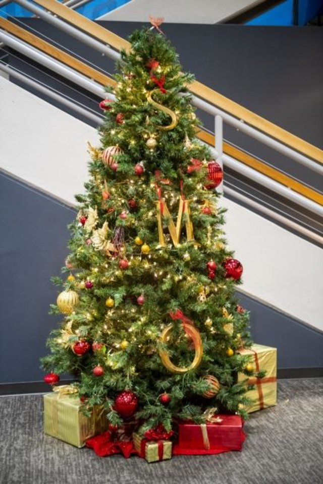 Photo -  A Christmas tree has been decorated at Science Museum Oklahoma. [PHOTO PROVIDED]