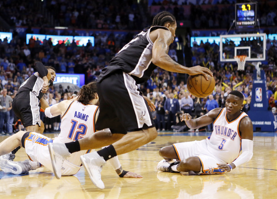 Photo - San Antonio's Kawhi Leonard (2) comes up with the ball between Oklahoma City's Steven Adams (12) and Victor Oladipo (5) after Russell Westbrook (0) had the Thunder's second-to-last shot blocked in an NBA basketball game between the Oklahoma City Thunder and San Antonio Spurs at Chesapeake Energy Arena in Oklahoma City, Friday, March 31, 2017. San Antonio won 100-95. Photo by Nate Billings, The Oklahoman