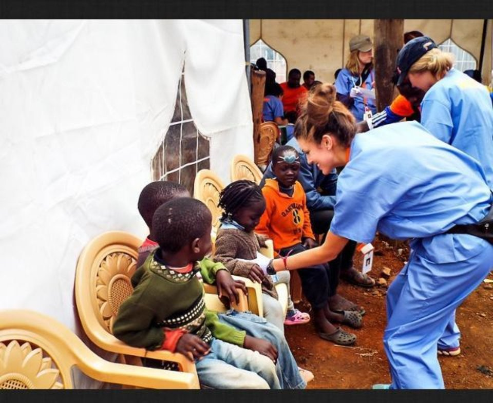 Photo -  Miss Oklahoma Alex Eppler works with children during a two-week trip in Kenya volunteering with International Medical Relief. PHOTO PROVIDED