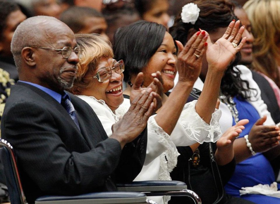 Photo -   Family members laugh and applaud a speaker during the memorial service for Clara Luper. At left is son Calvin Luper. Next to him is daughter Marilyn Hildreth. . About 2,500 people celebrated the life and legacy of Oklahoma City civil rights pioneer Clara Mae Shepard Luper  during a lively service in the Cox Convention Center that lasted more than three hours, Friday,  June 17, 2011. Photo by Jim Beckel, The Oklahoman