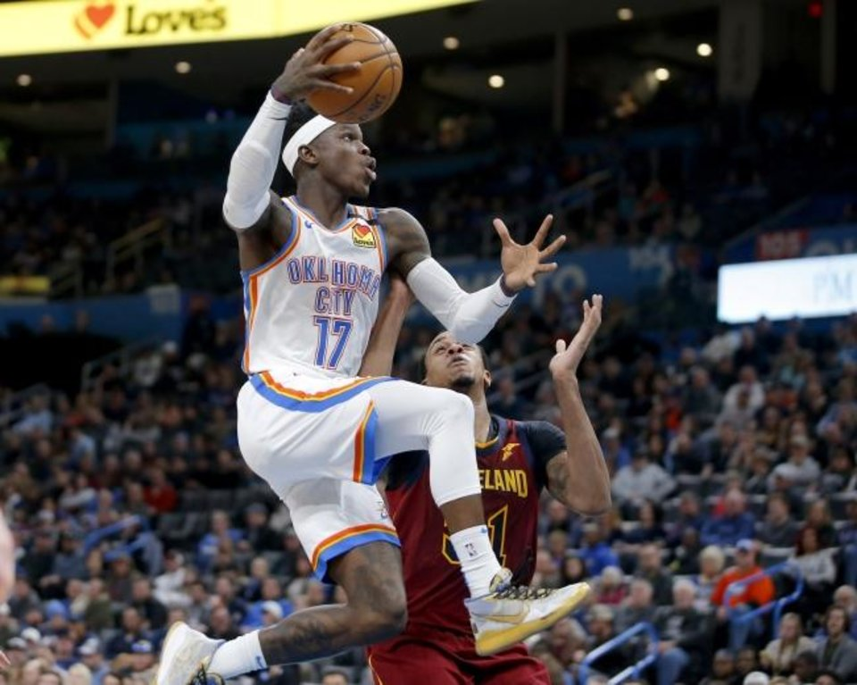 Photo -  Oklahoma City's Dennis Schroder (17) goes past Cleveland's John Henson (31) during an the Thunder's 109-103 win Wednesday at Chesapeake Energy Arena. [Bryan Terry/The Oklahoman]