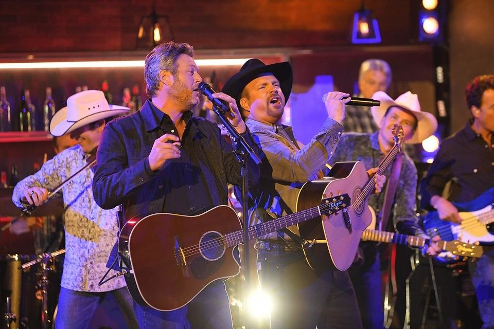 "Photo - Blake Shelton, left, and Garth Brooks perform ""Dive Bar"" at the 53rd annual CMA Awards at Bridgestone Arena, Wednesday, Nov. 13, 2019, in Nashville, Tenn. [AP Photo/Mark J. Terrill]"