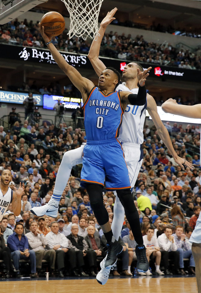 Photo - Oklahoma City Thunder guard Russell Westbrook (0) goes up for a shot that was blocked by Dallas Mavericks' Salah Mejri of Tunisia in the first half of an NBA basketball game, Wednesday, Feb. 24, 2016, in Dallas. (AP Photo/Tony Gutierrez)