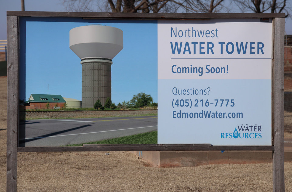 Photo -  A sign shows that the new northwest water tower in Edmond will look like when finished. [PHOTO BY DOUG HOKE, THE OKLAHOMAN]