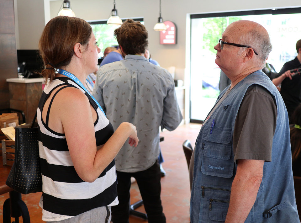 Photo - Sara Thompson, Director of Programming, talks with Shane Smith, Shorts Programmer, in between sessions of Short Talks@Stella Nova, a series of short discussions by filmmakers from deadCenter Film Festival, Friday, June 7, 2019. [Doug Hoke/The Oklahoman]