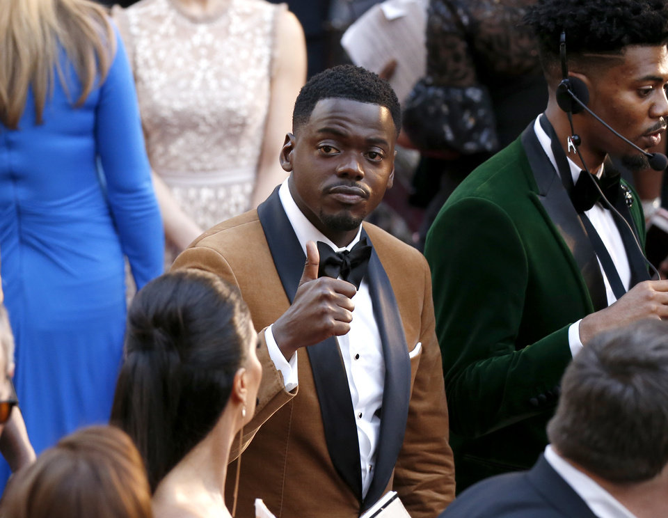 Photo - Daniel Kaluuya gestures as he arrives at the Oscars on Sunday, March 4, 2018, at the Dolby Theatre in Los Angeles. (Photo by Eric Jamison/Invision/AP)