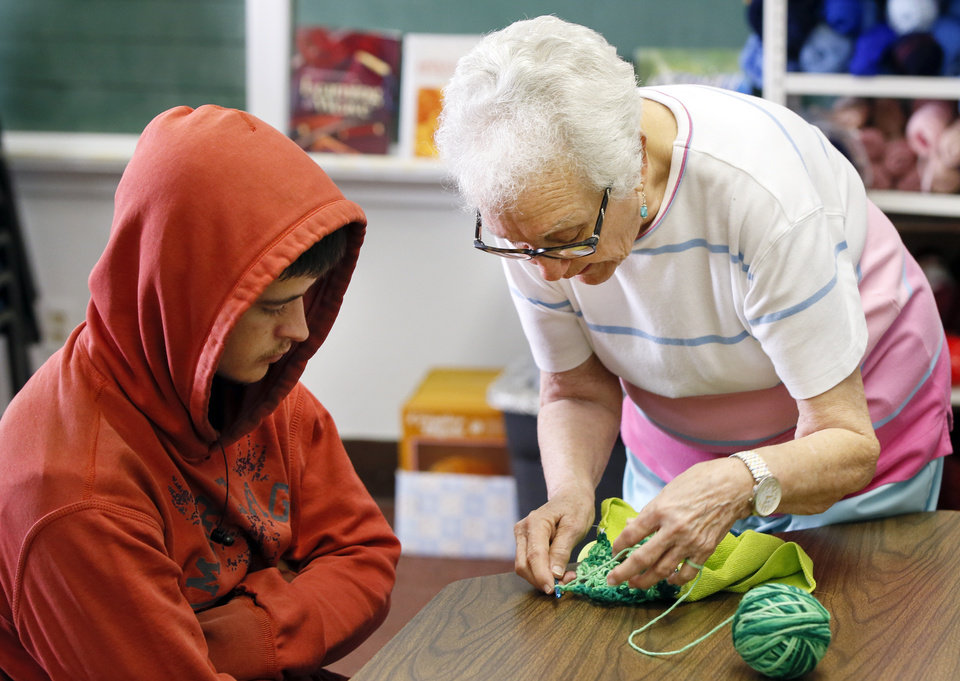 Photo -  Volunteer Neva Kitsmiller helps Brandon Fontenot, 18, of Walters, with crochet at FAME Academy. [Photo by Nate Billings, The Oklahoman]