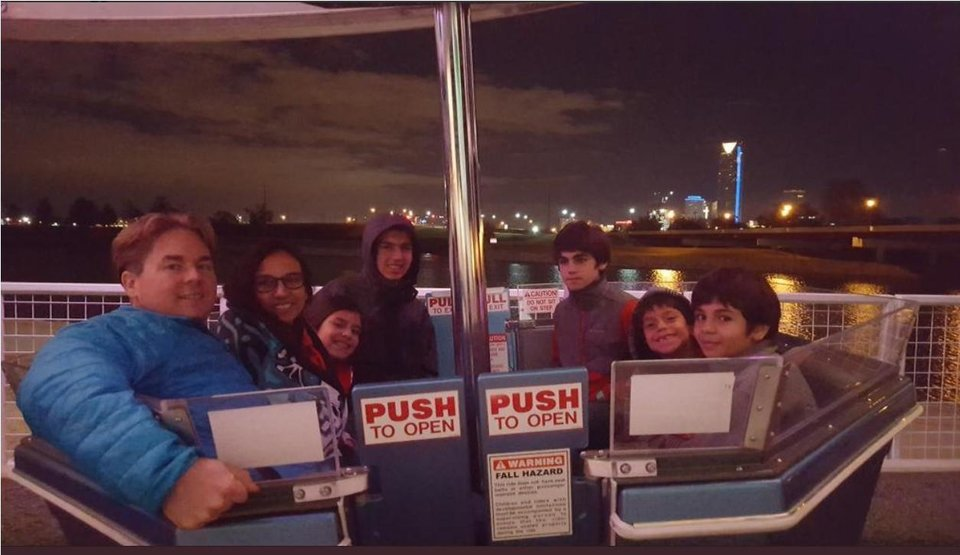 Photo -  Thomas and Yvonne Rossiter enjoy an evening with their kids atop the Ferris Wheel at Wheeler. [Photo provided]