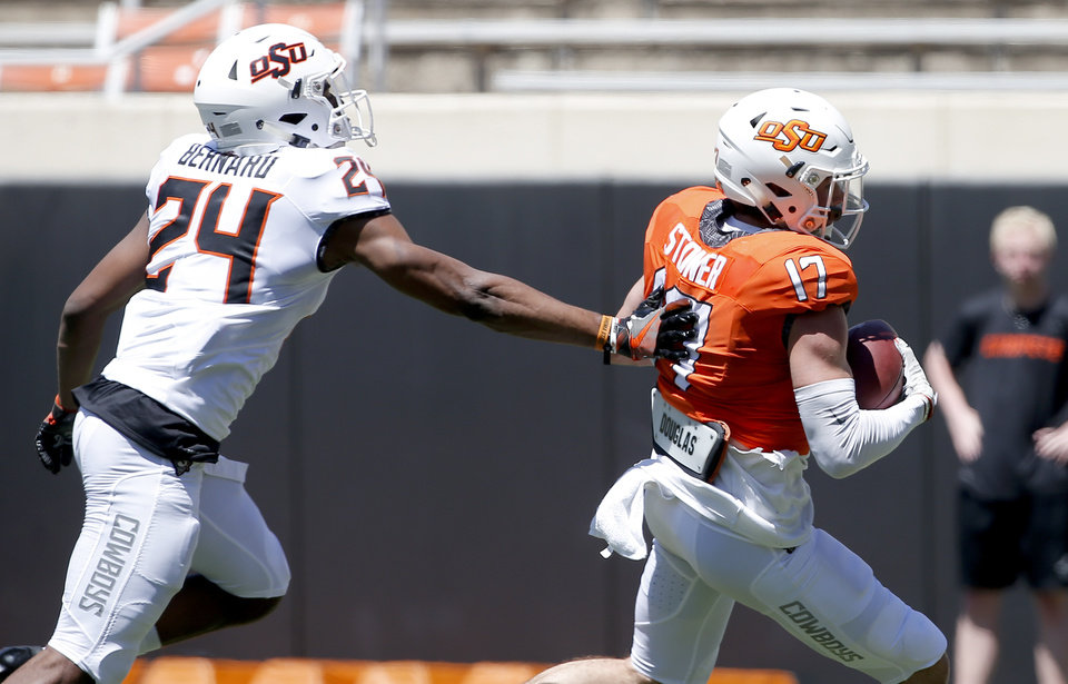 Photo - Oklahoma State's Dillon Stoner (17) gets by OSU's Jarrick Bernard during the Oklahoma State Cowboys spring practice at Boone Pickens Stadium in Stillwater, Okla., Saturday, April 20, 2019.  Photo by Sarah Phipps, The Oklahoman