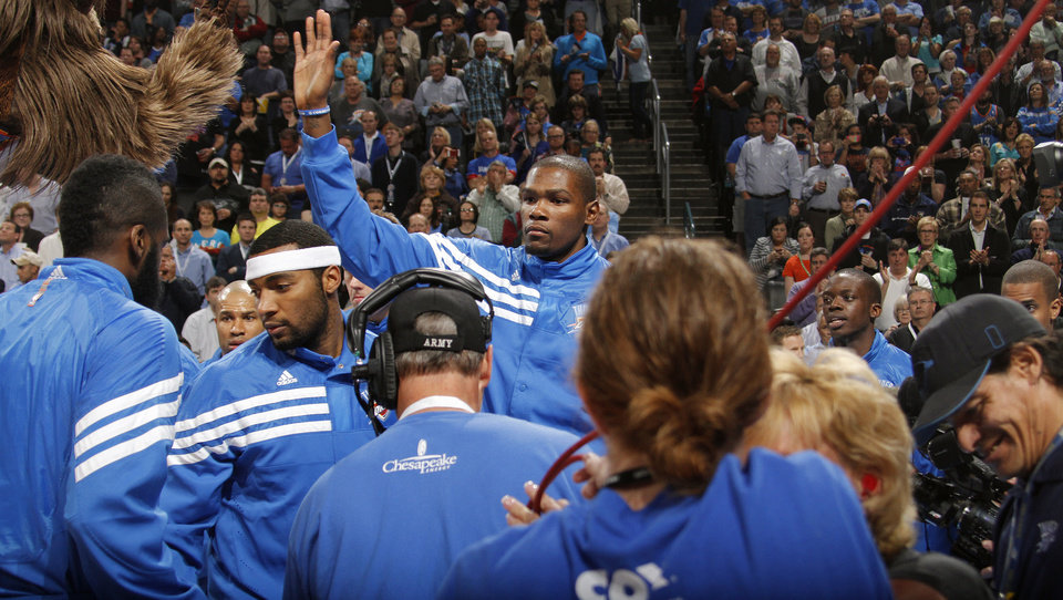 Photo - Oklahoma City Thunder small forward Kevin Durant (35) gives out high fives in pre game during the NBA basketball game between the Oklahoma City Thunder and the Los Angeles Clippers at Chesapeake Energy Arena on Wednesday, March 21, 2012 in Oklahoma City, Okla.  Photo by Chris Landsberger, The Oklahoman