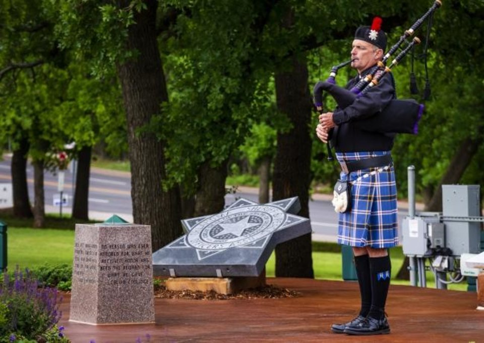 Photo -  Lt. Curtis Burns, Oklahoma State University Police Department, plays the bagpipes during the 51st Annual Oklahoma Law Enforcement Officer's Memorial Service at The Oklahoma Law Enforcement Memorial in Oklahoma City on Friday. [Chris Landsberger/The Oklahoman]
