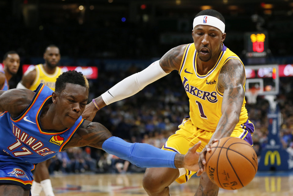 Photo - Oklahoma City's Dennis Schroder (17) and Los Angeles' Kentavious Caldwell-Pope (1) chase the ball in the third quarter during an NBA basketball game between the Oklahoma City Thunder and the Los Angeles Lakers at Chesapeake Energy Arena in Oklahoma City, Friday, Nov. 22, 2019. The Lakers won 130-127. [Nate Billings/The Oklahoman]