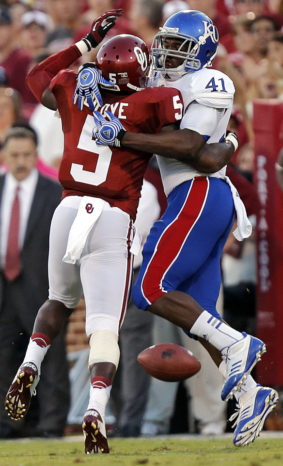 Photo - OU's Joseph Ibiloye (5) breaks up a pass for KU's Jimmay Mundine (41) during the college football game between the University of Oklahoma Sooners (OU) and the University of Kansas Jayhawks (KU) at Gaylord Family-Oklahoma Memorial Stadium on Saturday, Oct. 20th, 2012, in Norman, Okla. Photo by Chris Landsberger, The Oklahoman