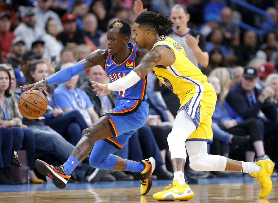 Photo - Oklahoma City's Dennis Schroder (17) tracks down a loose ball as Golden State's D'Angelo Russell (0) defends during the NBA game between the Oklahoma City Thunder and the Golden State Warriors at Chesapeake Energy Arena,   Saturday, Nov. 9, 2019.  [Sarah Phipps/The Oklahoman]