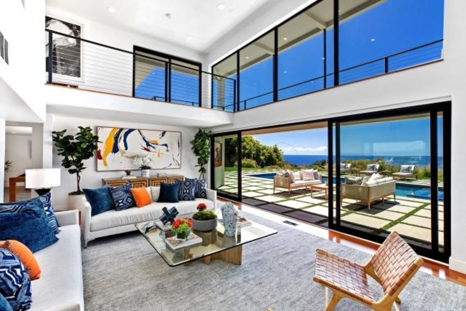 Photo -  Designed to take in the views, the contemporary-style beach house that belonged to actor Robert Conrad features floor-to-ceiling windows and a wrap-around balcony on the second level. [TNS]