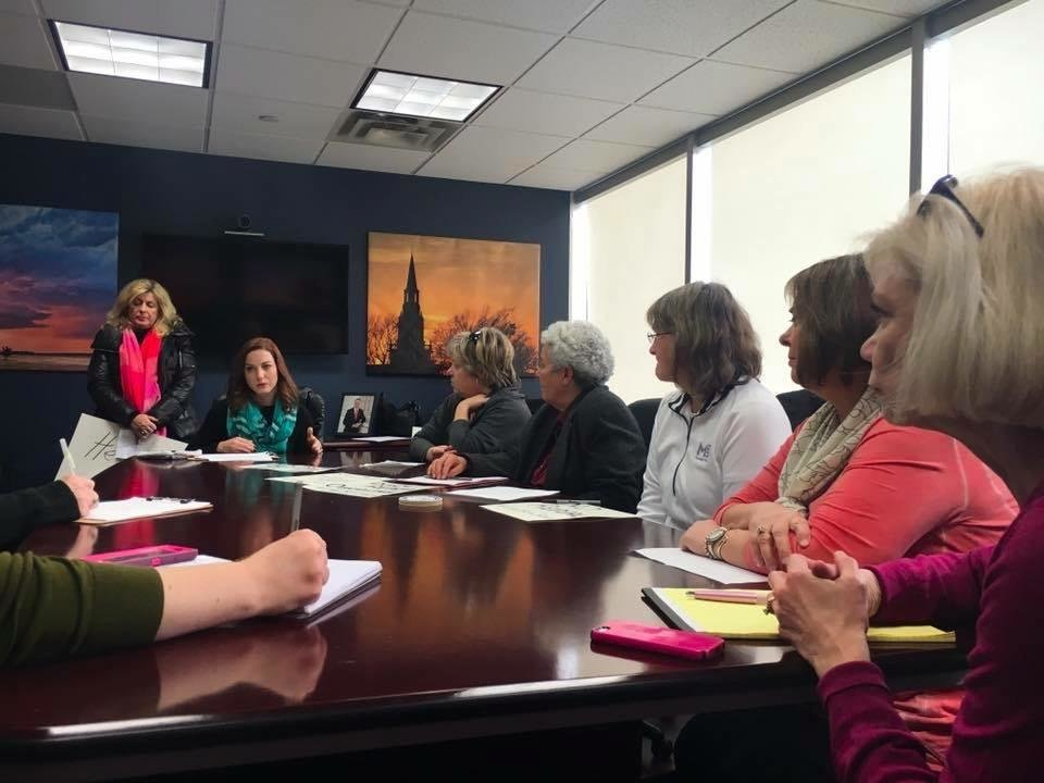 Photo -  On Thursday, Sabine Brown, in green scarf, joined a group of other families who went to Sen. James Lankford's office in Tulsa to share their family's story and concern about Congress' plan to repeal the Affordable Care Act, also known as Obamacare. [Photo provided]