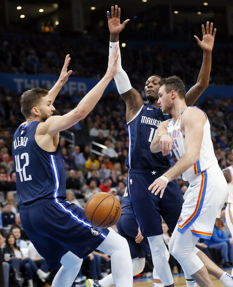 Photo - Oklahoma City's Danilo Gallinari (8) passes away from Dallas' Dorian Finney-Smith (10), center, and Maxi Kleber (42) in the second quarter during an NBA basketball game between the Oklahoma City Thunder and Dallas Mavericks at Chesapeake Energy Arena in Oklahoma City, Monday, Jan. 27, 2020. [Nate Billings/The Oklahoman]