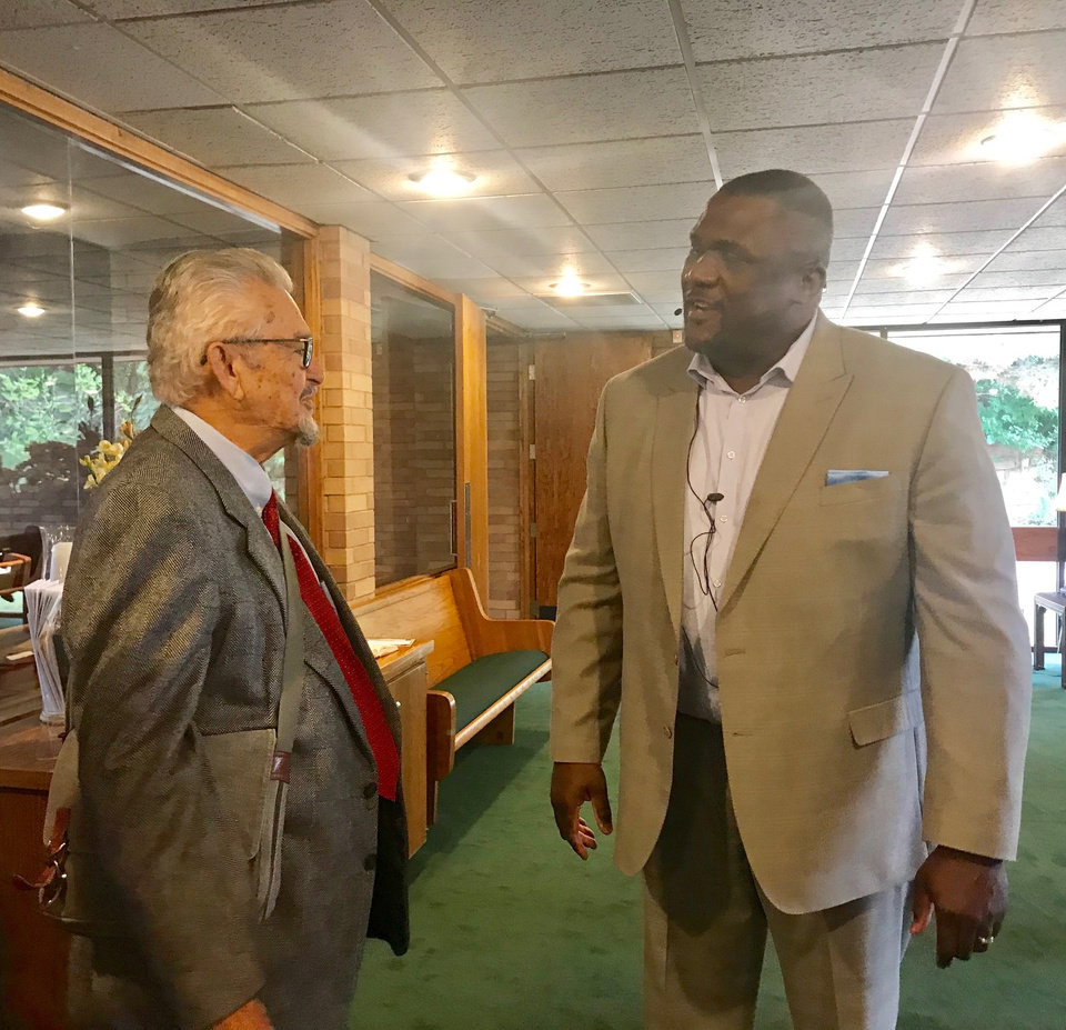 Photo -  George Goodner talks with the Rev. Dwayne Rodgers after the 11 a.m. worship service on Sept. 30 at Western Oaks Christian Church (Disciples of Christ), 8100 NW 23. [Photo by Carla Hinton, The Oklahoman]