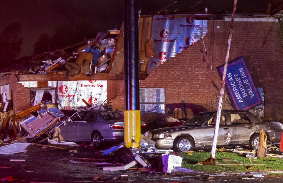 Photo - Tornado damage to the American Budget Value Inn in El Reno, Okla. on Sunday, May 26, 2019.  [Chris Landsberger/The Oklahoman]