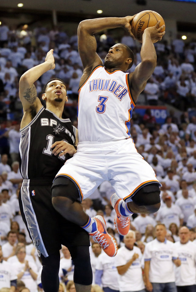Photo - Oklahoma City's Dion Waiters (3) shoots against San Antonio's Danny Green (14) during Game 4 of the Western Conference semifinals between the Oklahoma City Thunder and the San Antonio Spurs in the NBA playoffs at Chesapeake Energy Arena in Oklahoma City, Sunday, May 8, 2016. Oklahoma City won 111-97. Photo by Nate Billings, The Oklahoman