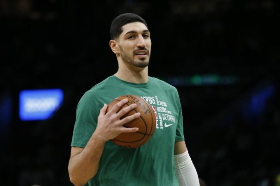 Photo -  Boston Celtics center Enes Kanter holds a ball during warmups before the start of an NBA basketball game against the Atlanta Hawks, Friday, Feb. 7, 2020, in Boston. (AP Photo/Mary Schwalm)