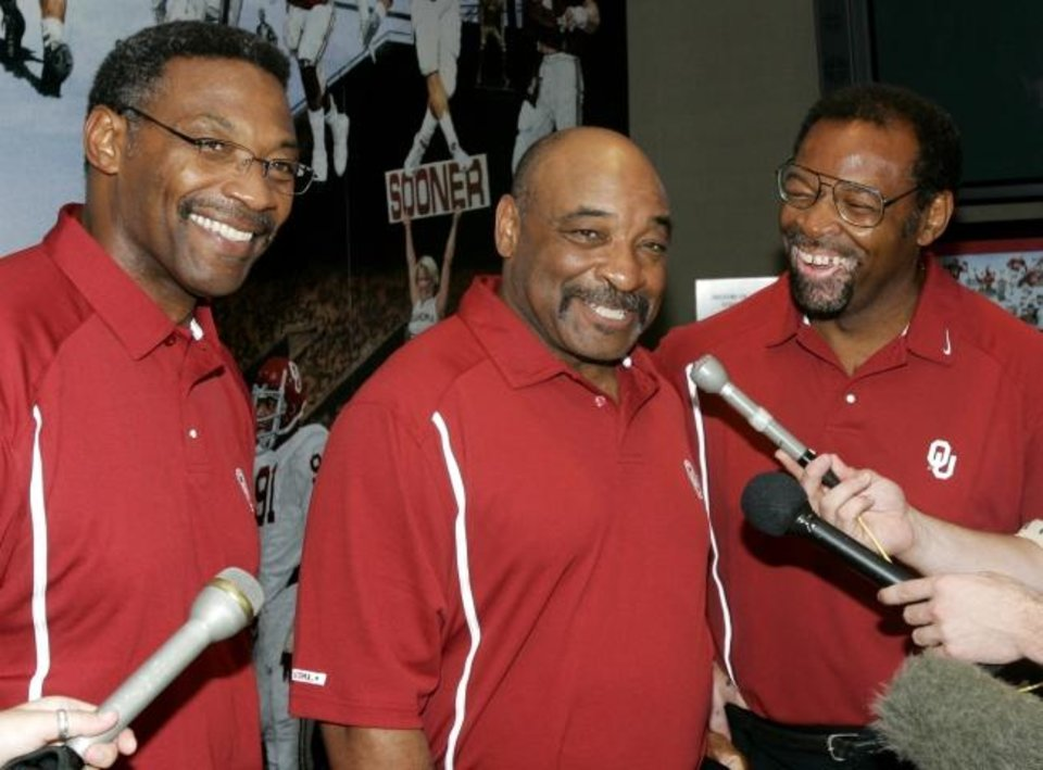 Photo -  Lee Roy Selmon, Lucious Selmon and Dewey Selmon talk to reporters at the Switzer Center in Norman in 2005. [OKLAHOMAN ARCHIVES]