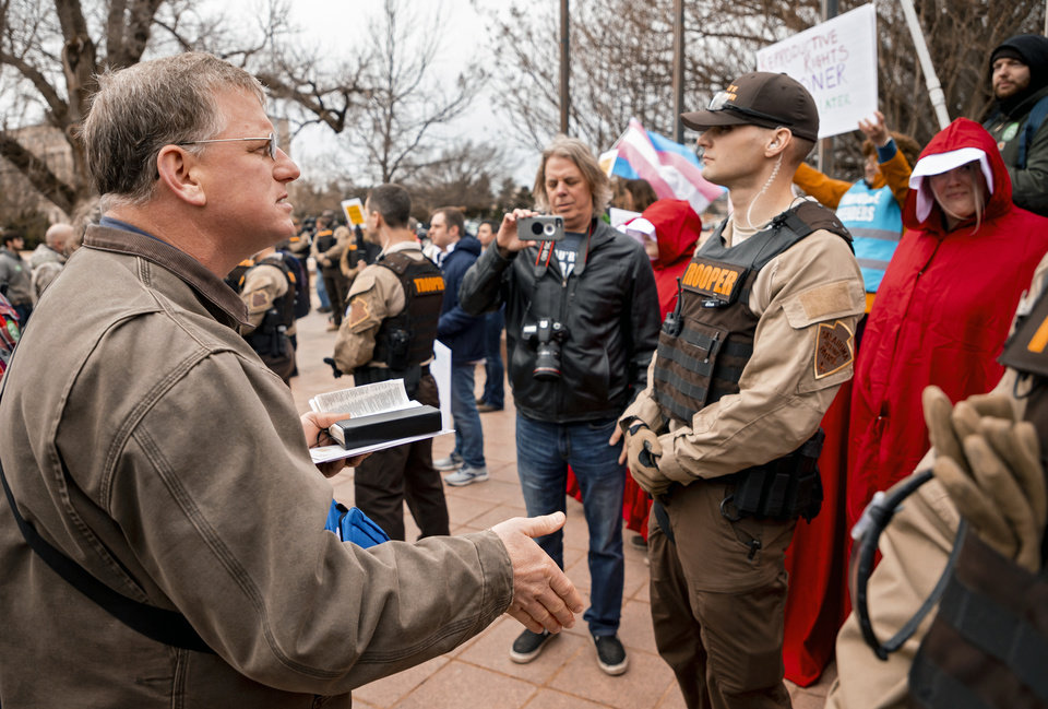 Photo - Pro-Life supporter Coleman Boyd read scripture to Pro-Choice supporters during a rally at the State Capitol in Oklahoma City, Okla. on Tuesday, Feb. 11, 2020.  [Chris Landsberger/The Oklahoman]