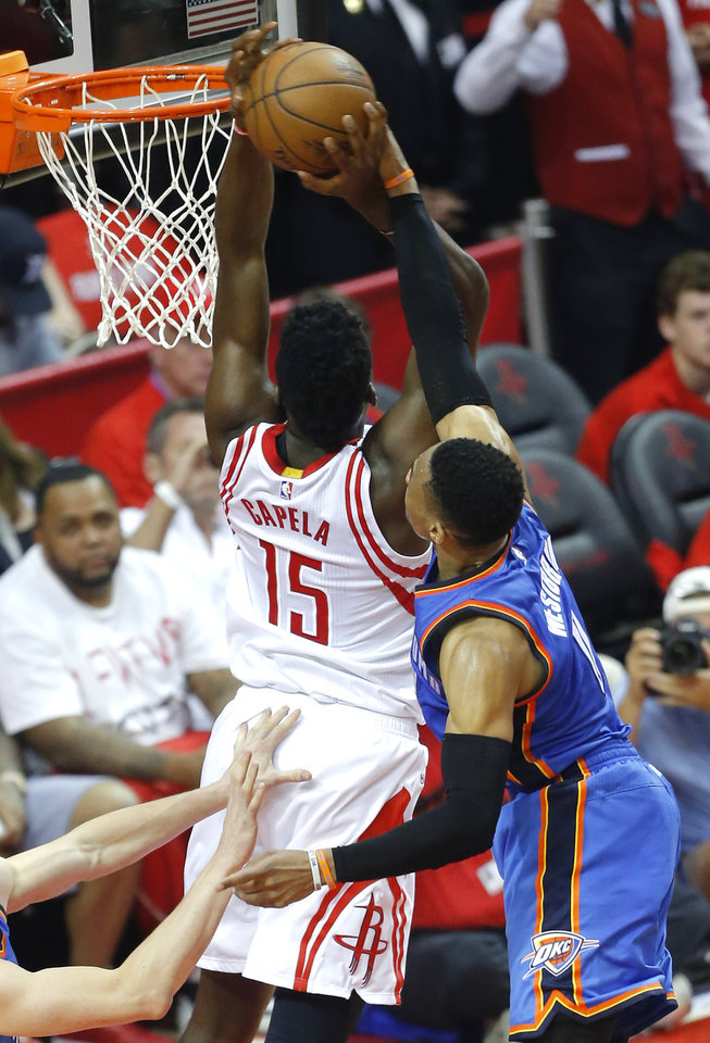 Photo - Oklahoma City's Russell Westbrook (0) blocks the shot of Houston's Clint Capela (15) during Game 2 in the first round of the NBA basketball playoffs between the Oklahoma City Thunder and the Houston Rockets at the Toyota Center in Houston, Texas,  Wednesday, April 19, 2017.  Photo by Sarah Phipps, The Oklahoman
