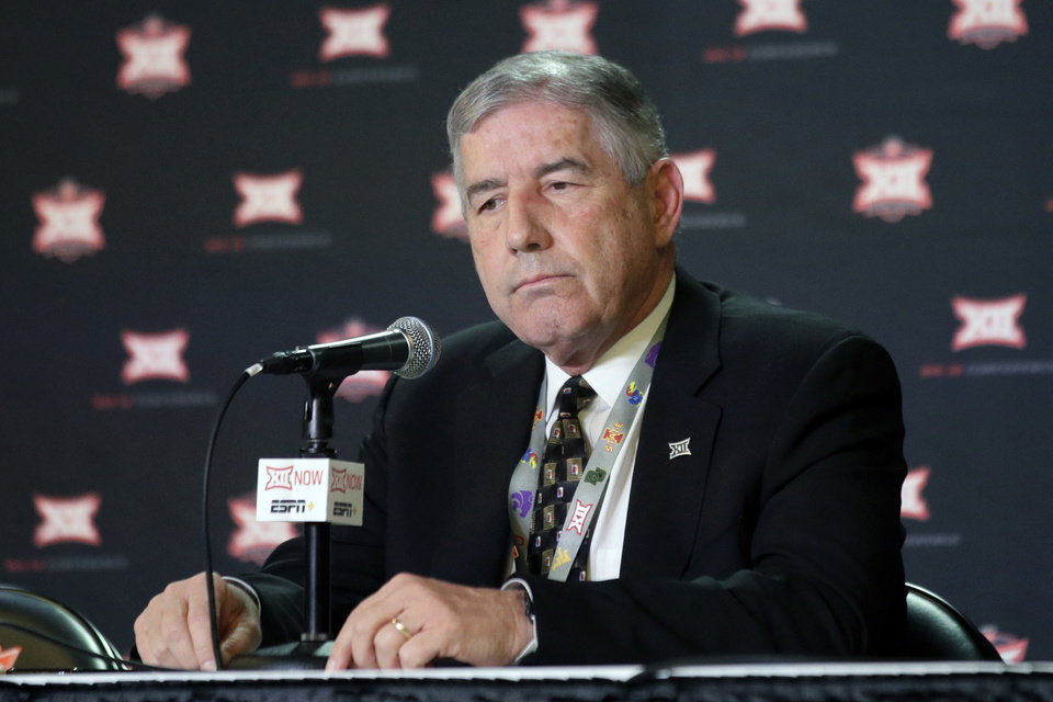 Photo - Big 12 Commissioner Bob Bowlsby announces no fans will be admitted to the rest of the Big 12 basketball tournament in Kansas City, Kan., Wednesday, March 11, 2020. The announcement came as fans gathered for the first round of the tournament. (AP Photo/Orlin Wagner)