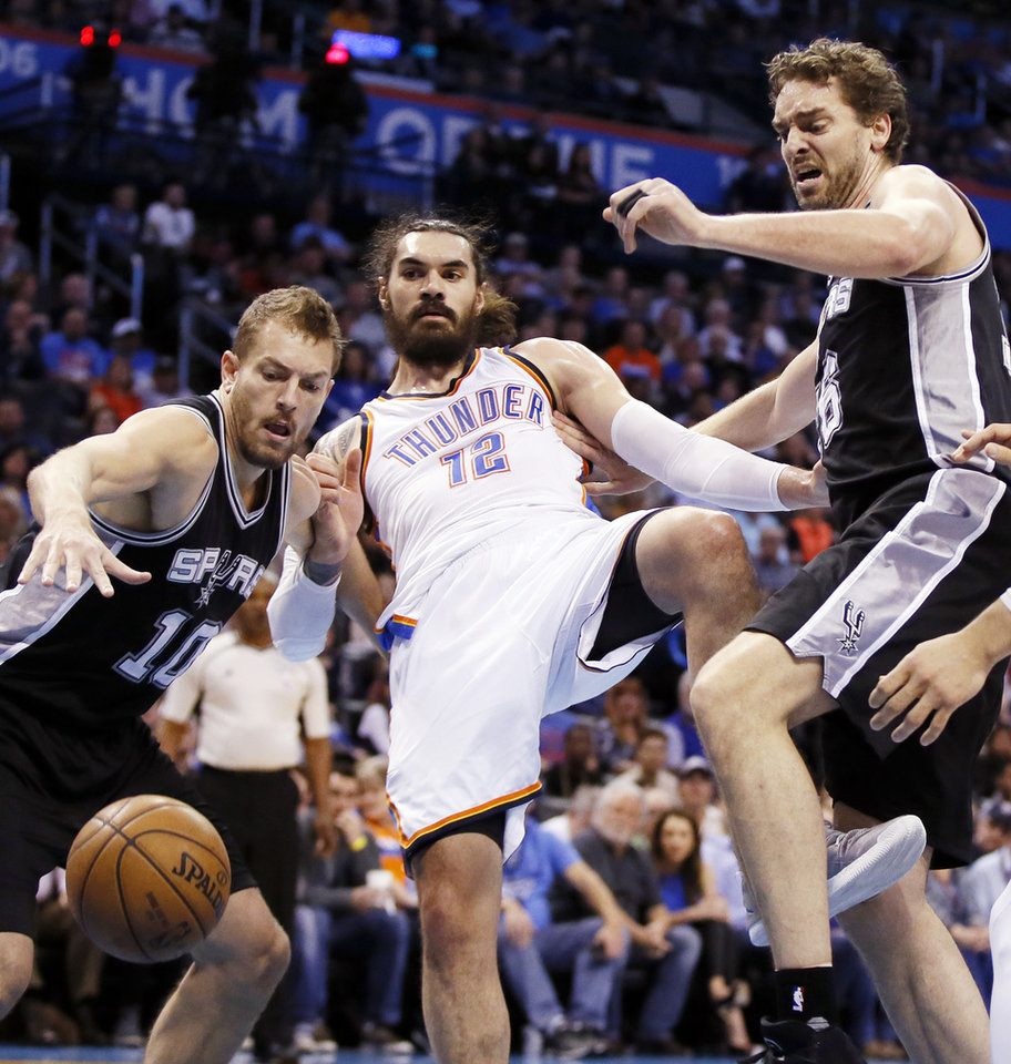 Photo - From left, San Antonio's David Lee (10), Oklahoma City's Steven Adams (12) and San Antonio's Pau Gasol (16) battle for a loose ball during an NBA basketball game between the Oklahoma City Thunder and San Antonio Spurs at Chesapeake Energy Arena in Oklahoma City, Friday, March 31, 2017. Photo by Nate Billings, The Oklahoman