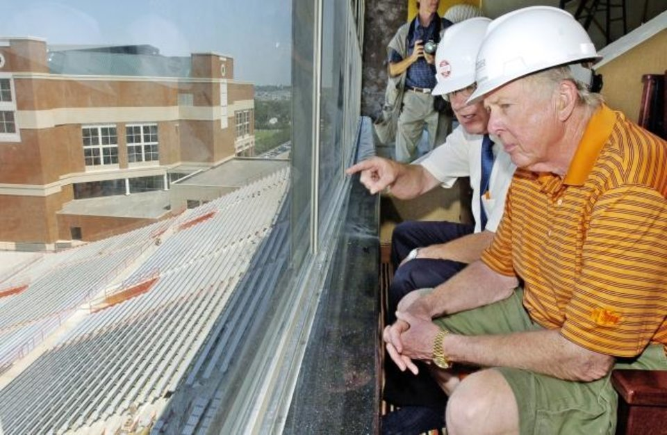 Photo -  T. Boone Pickens tours his luxury box at Boone Pickens Stadium in 2004.  Former OSU president Dr. David Schmidly is to Pickens' right. [The Oklahoman Archives]
