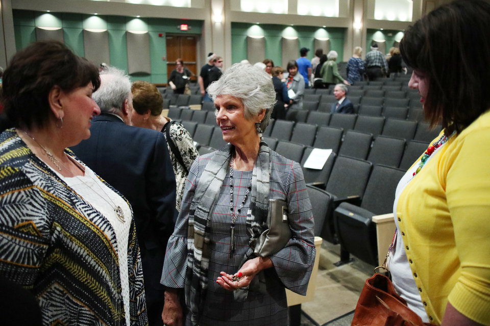 "Photo - Helga Page, who survived the Holocaust, talks with friends after the ""Testimony of a Child, the Holocaust Remembrance Day program at Bishop McGuinness High School auditorium, Sunday, May 5, 2019. [Doug Hoke/The Oklahoman]"