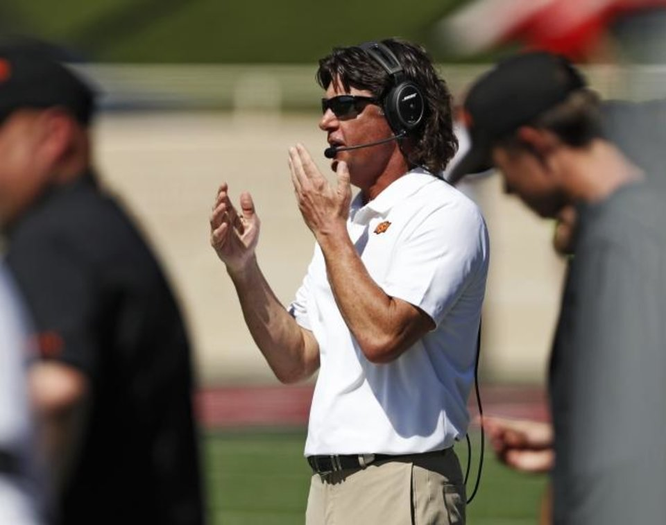 Photo -  Oklahoma State coach Mike Gundy reacts to a play during the second half of the Cowboys' loss to Texas Tech on Saturday in Lubbock, Texas. [AP Photo/Brad Tollefson]